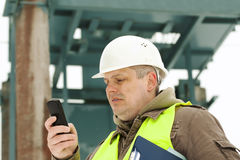 Engineer with cell phone Stock Image