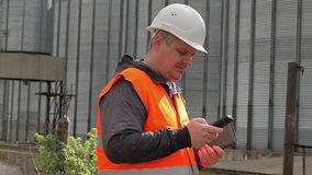 Engineer with cell phone at the factory stock video