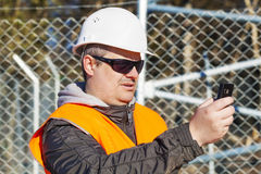 Engineer with the cell phone Stock Image