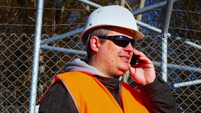 Engineer with the cell phone stock footage