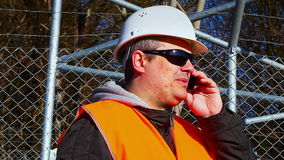 Engineer with the cell phone stock video
