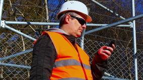 Engineer with the cell phone Royalty Free Stock Image