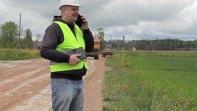 Engineer with cell phone in road repairs stock video footage