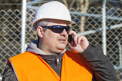 Engineer with the cell phone Stock Photography
