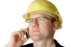 Engineer with cellphone. Engineer on cellphone Royalty Free Stock Image