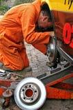 Engineer changing brake disc Royalty Free Stock Photo