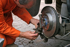 Engineer changing brake disc Stock Photography