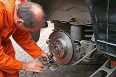 Engineer changing brake disc Royalty Free Stock Photos