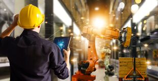 Free Engineer Check And Control Automation Robot Arms Machine In .modern Warehouse Industrial On Real Time Monitoring System Software. Royalty Free Stock Photos - 216495448
