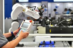Engineer check and control automation Robot arm. Machine for Automotive bearings packing process in factory stock photography