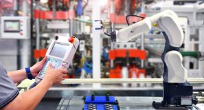 Engineer check and control automation Robot arm. Machine for Automotive bearings packing process in factory royalty free stock photos