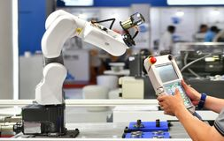 Engineer check and control automation Robot arm. Machine for Automotive bearings packing process in factory royalty free stock image