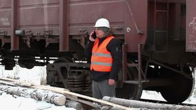 Engineer check the freight wagons stock footage