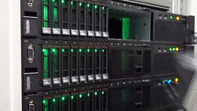 IT Engineer check hard drive in server room. Cluster Server Data Room. Concept 3.0. RUSSIA, MOSCOW - January 13, 2019: IT Engineer check hard drive in server stock video footage