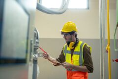 Free Engineer Checking And Maintenance Technical Data Of System Equipment Condenser Water Pump Stock Image - 215473401