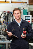 Engineer Checking Component In Factory Royalty Free Stock Photography