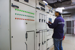 Engineer checking the electrical system Stock Image