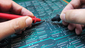 Engineer checking electronic board Stock Image