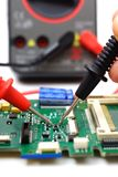Engineer is checking electronic component Royalty Free Stock Image