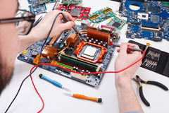 Engineer checking motherboard with multimeter Stock Images