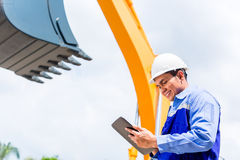 Engineer checking plans on construction site Royalty Free Stock Photography