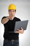 Engineer checking on production on laptop Stock Photos