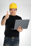 Engineer checking on production on laptop Stock Photo