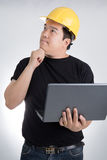 Engineer checking on production on laptop Royalty Free Stock Image