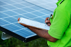 Engineer checking solar  station Royalty Free Stock Photo