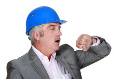 Engineer checking the time Stock Photography