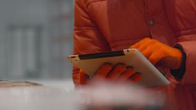 Engineer checks the documents on tablet inside new modern industry warehouse stock footage