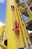 Engineer climbing access shaft Royalty Free Stock Photos