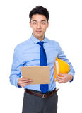 Engineer with clipboard and yellow helmet Royalty Free Stock Images