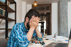 Engineer closed his face in despair, free space Royalty Free Stock Images