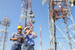 Engineer communications check Antenna. On blue sky background Stock Images