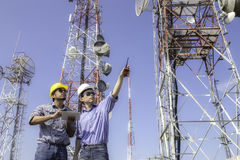 Engineer communications check Antenna. On blue sky background Stock Image