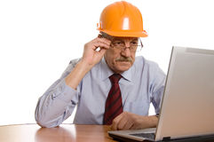 Engineer at the computer isolated Stock Photography