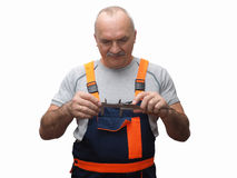 The engineer in construction pants holding trammel Royalty Free Stock Images