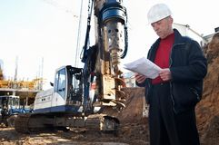 Engineer at construction site. Builder inspector worker at construction site with documentation Stock Images