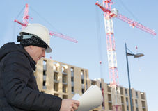 An engineer on a construction site with cranes Stock Images