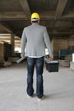 Engineer at a construction site making a business call Royalty Free Stock Images