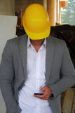 Engineer at a construction site making a business call Stock Photo