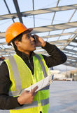 Engineer construction talking mobile phone under new building Stock Images