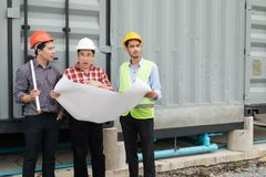 Engineer and construction team wearing safety helmet and blueprint on hand. they are checking construction process. Engineer and construction team wearing safety royalty free stock photos