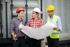 Engineer and construction team wearing safety helmet and blueprint on hand. engineer and client checking construction process. Engineer and construction team royalty free stock photo
