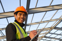 Engineer construction under new building checking plan. Horizontal image stock image