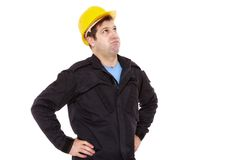 Engineer constructor looks up and sighs Royalty Free Stock Images