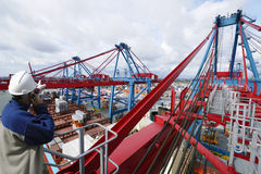Engineer, containers and cranes royalty free stock photo