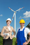 Engineer and contractor posing in front of wind turbine Royalty Free Stock Images