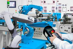 Engineer control automatic robotic at industrial. Engineer control automatic robotic hand machine tool at industrial manufacture Stock Photo